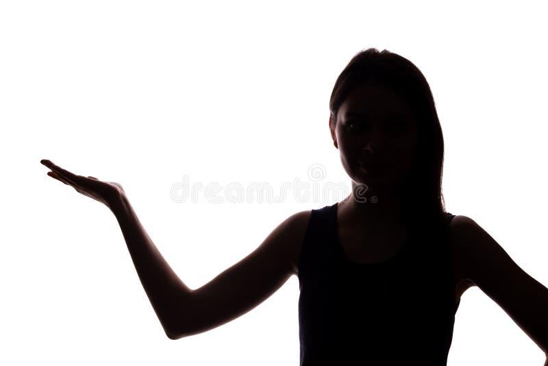 La mujer joven en traje muestra su dedo ?ndice, mano adelante foto de archivo libre de regalías