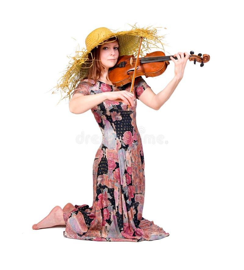 La mujer joven juega la viola foto de archivo libre de regalías