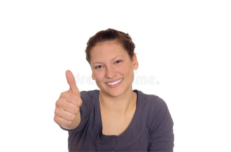 La mujer joven muestra el pulgar para arriba imagenes de archivo