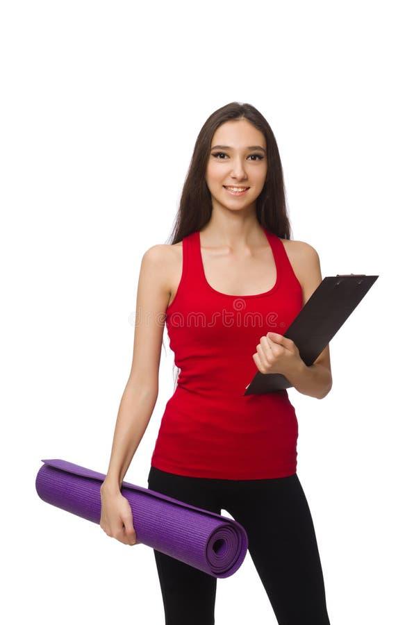 La mujer joven que hace ejercicios en blanco fotos de archivo libres de regalías