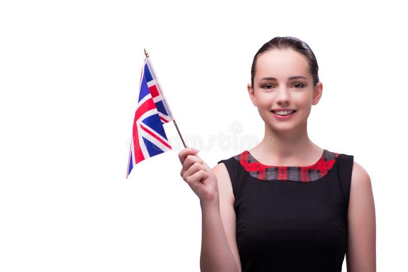 La mujer joven que sostiene la bandera británica imágenes de archivo libres de regalías