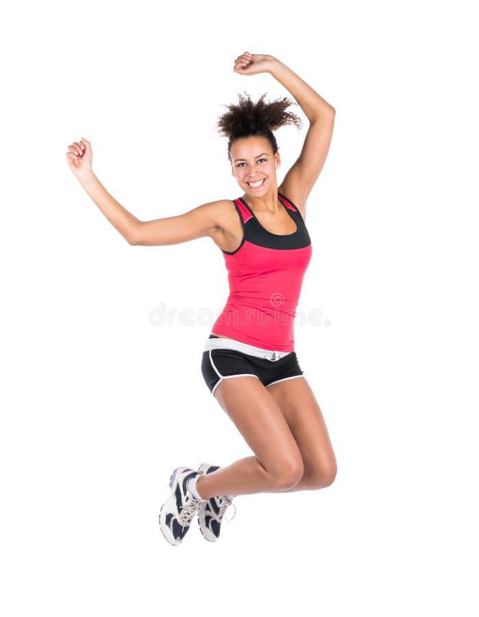 La mujer joven salta imagen de archivo