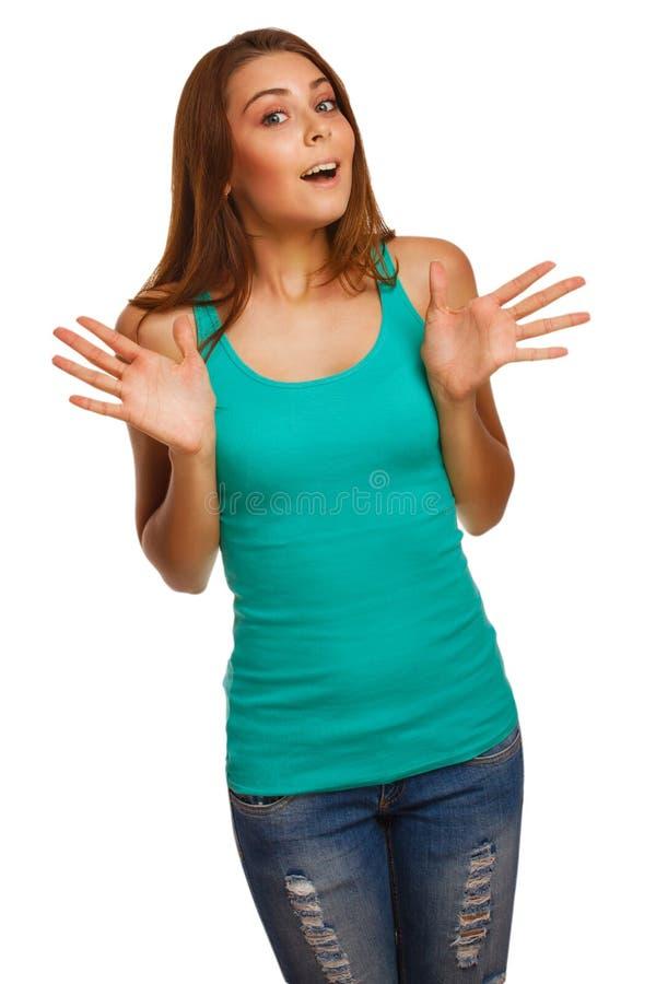 La mujer morena sorprendida muchacha emocionada lanza para arriba foto de archivo