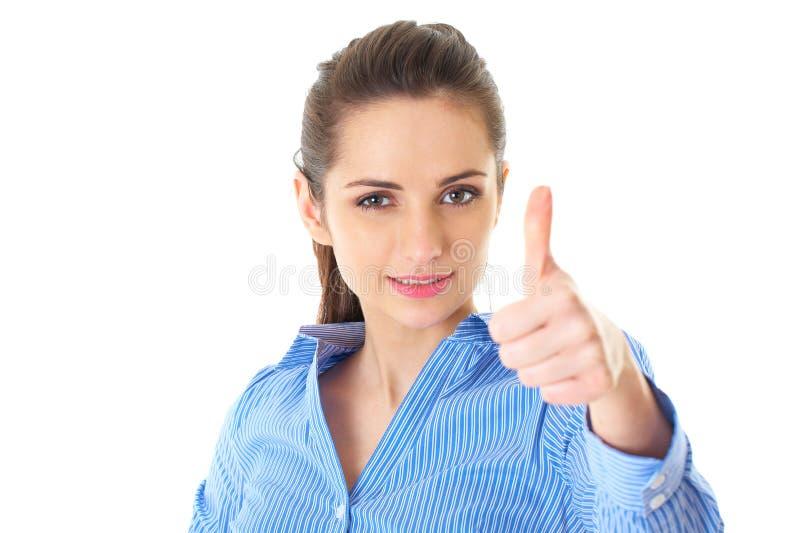 La mujer muestra el pulgar para arriba, camisa azul, aislada fotos de archivo
