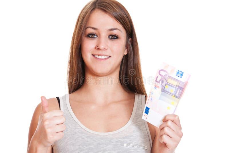 La mujer muestra los pulgares para arriba y el euro 50 imagen de archivo