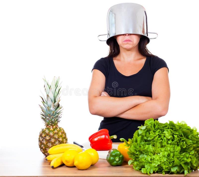 La mujer no quiere cocinar foto de archivo libre de regalías