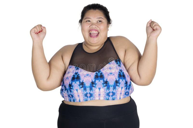 La mujer obesa joven sea éxito para perder el peso imagenes de archivo