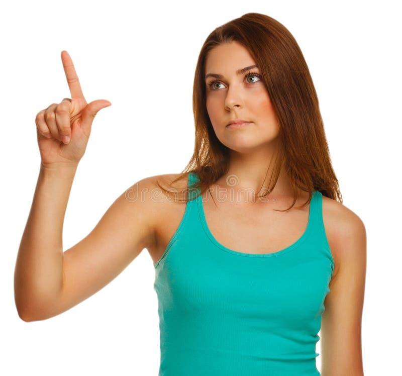 La mujer presiona el botón del finger de los puntos de la pantalla táctil imagen de archivo