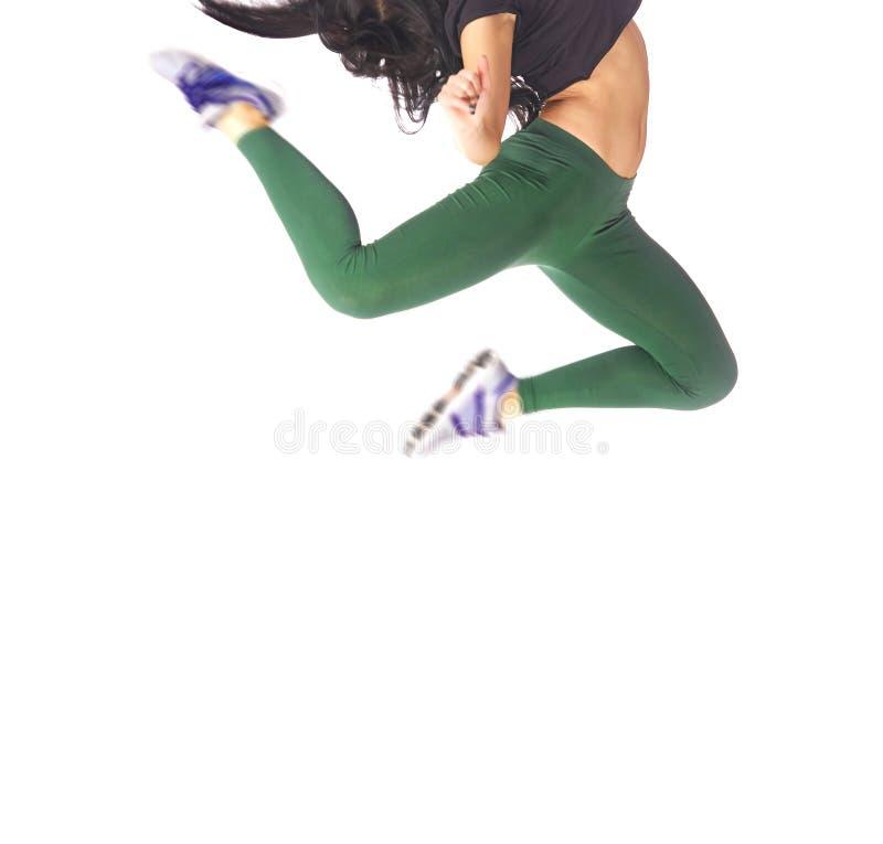 La mujer que salta y que baila en un fondo blanco imágenes de archivo libres de regalías