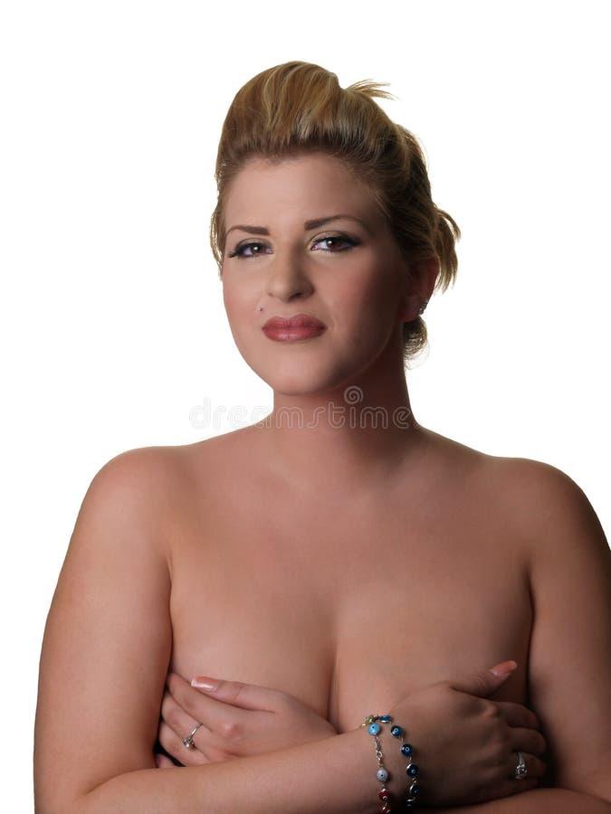 La mujer rubia grande con entrega los pechos foto de archivo
