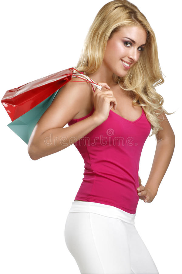 La mujer rubia hermosa feliz joven va a hacer compras imagenes de archivo