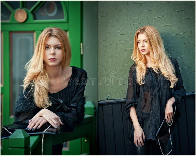 La mujer rubia joven encantadora en la blusa negra que presentaba delante de un verde pintó el marco de puerta fotos de archivo