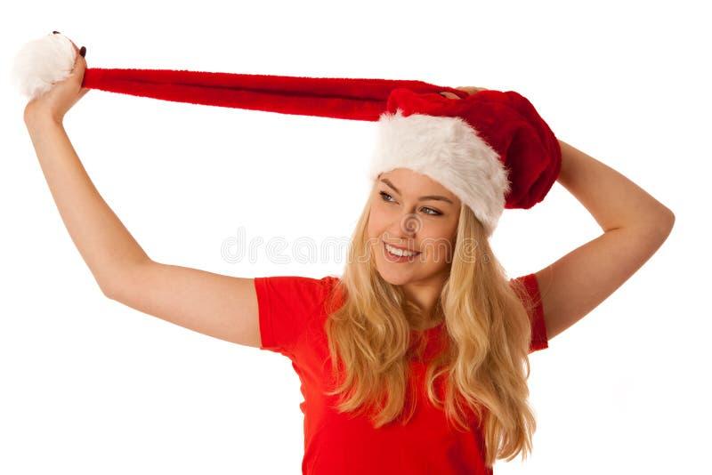 La mujer rubia linda con el sombrero de santa siolated sobre el fondo blanco foto de archivo libre de regalías
