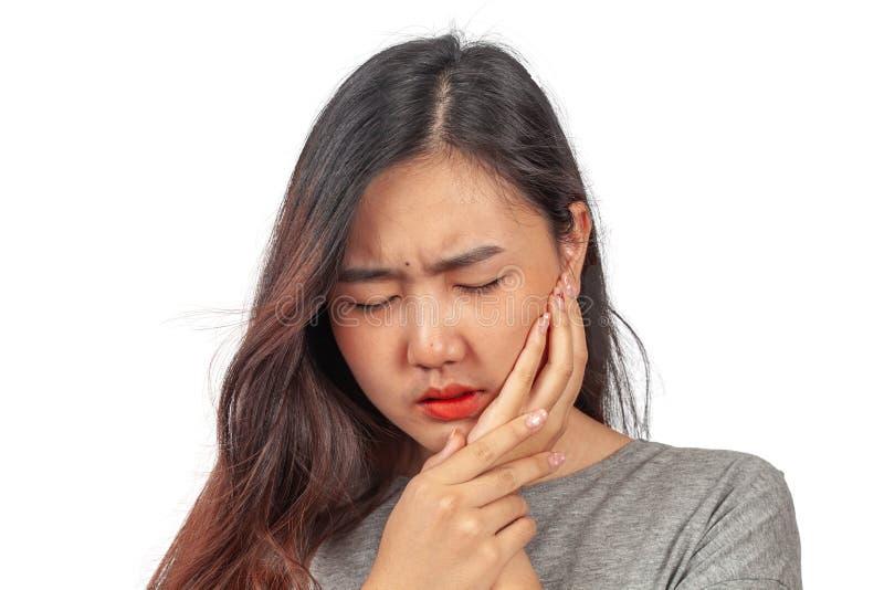 La mujer sufre del dolor del diente, salud foto de archivo