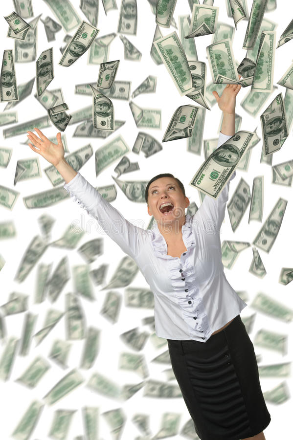 La mujer y es mucho dinero que cae de arriba imagenes de archivo