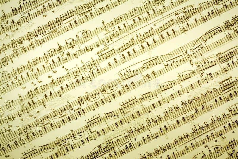 La musica nota la priorità bassa fotografie stock