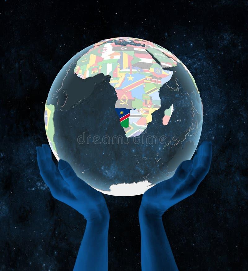 La Namibie sur le globe politique dans des mains illustration libre de droits