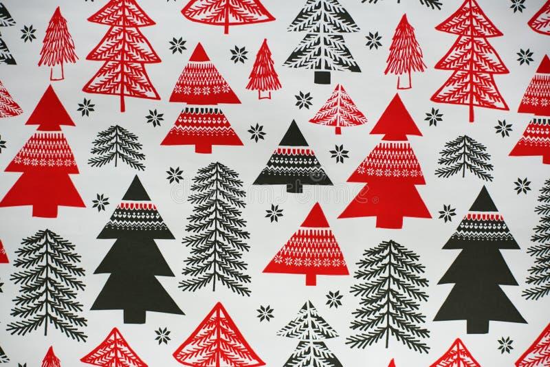 La Navidad diseñó el ornamento de la textura con los árboles negros y rojos fotografía de archivo