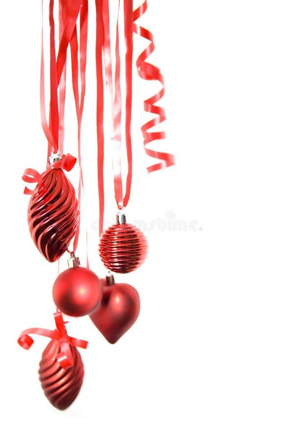 La Navidad roja adorna aislado fotografía de archivo