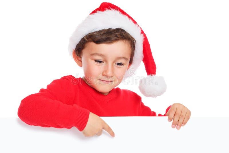 La Navidad Santa Claus del muchacho del niño del niño que señala el copyspace vacío de la bandera aislado imágenes de archivo libres de regalías