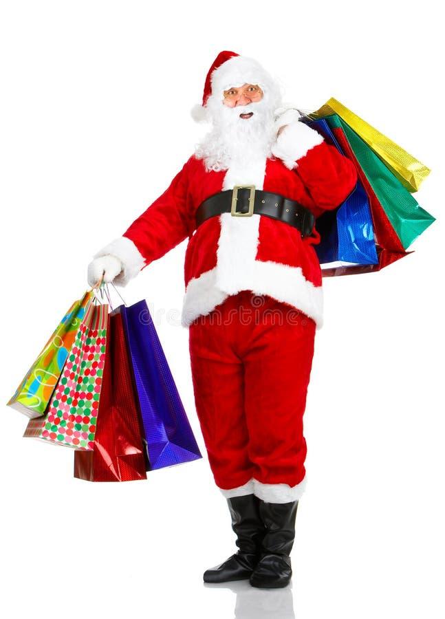 La Navidad Santa de las compras fotos de archivo