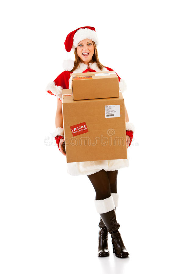 La Navidad: Santa Girl con la pila de cajas fotos de archivo libres de regalías