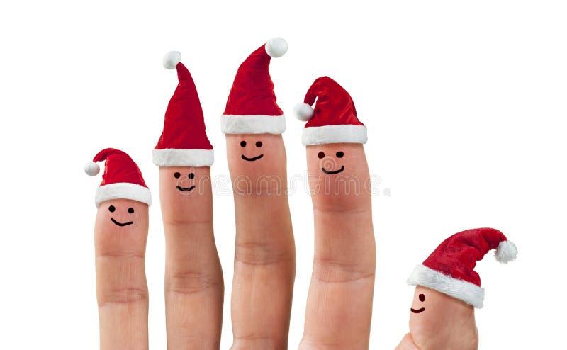 La Navidad Santa Hat Fingers fotografía de archivo libre de regalías
