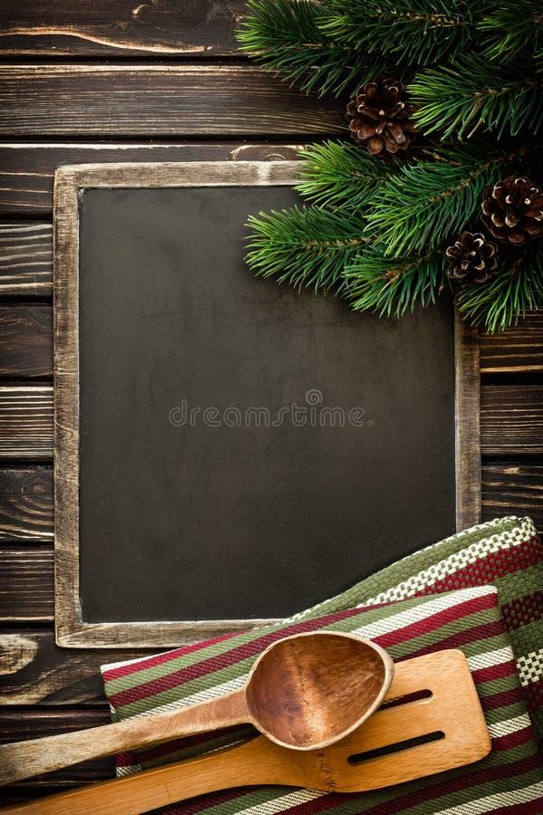 La Navidad y cocinar el fondo de las comidas imagen de archivo
