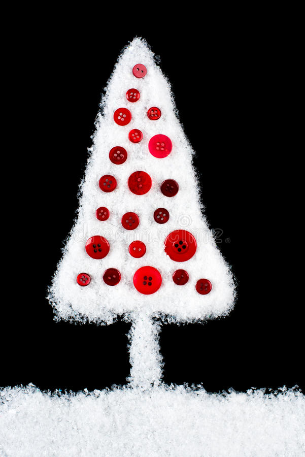 La neige a couvert l'arbre de Noël images stock