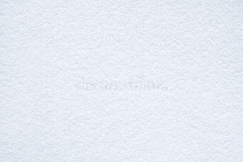 La neve ha gradito la struttura del feltro di bianco immagine stock