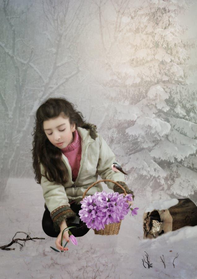 La niña con los snowdrops imagen de archivo libre de regalías