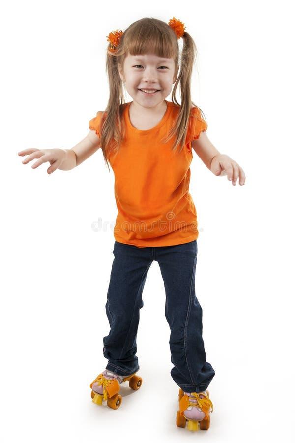 La niña en pcteres de ruedas fotografía de archivo