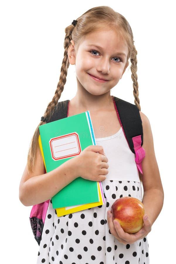 La niña feliz empieza la escuela, retrato, aislado imagenes de archivo