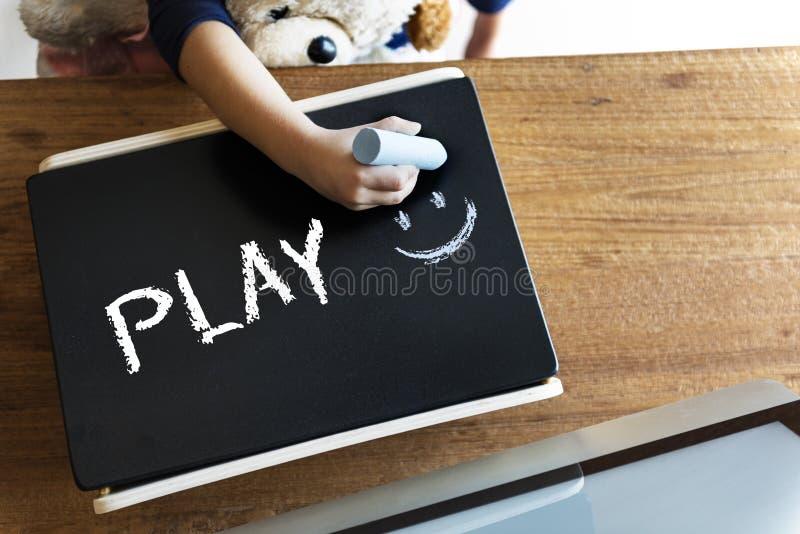 La niñez de los niños disfruta de concepto de la actividad del juego de la diversión foto de archivo libre de regalías