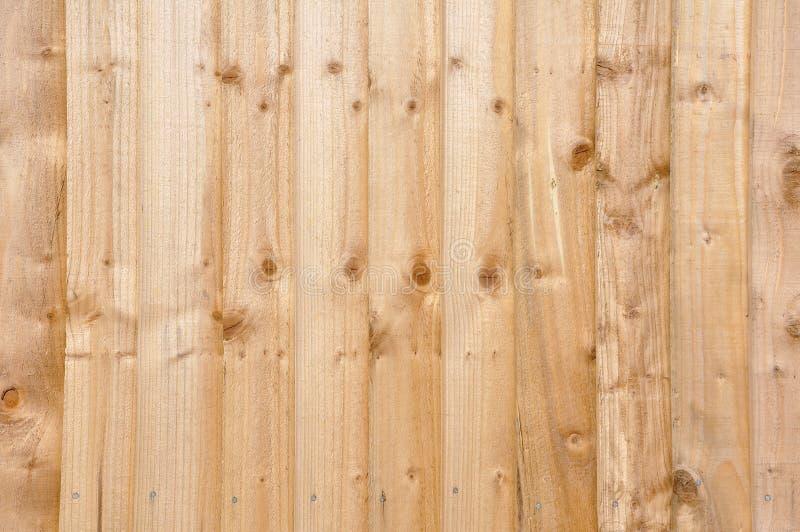La nueva cerca de madera artesona el fondo fotos de archivo