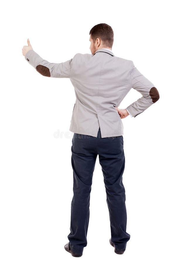 La opinión trasera el hombre de negocios muestra los pulgares para arriba fotografía de archivo