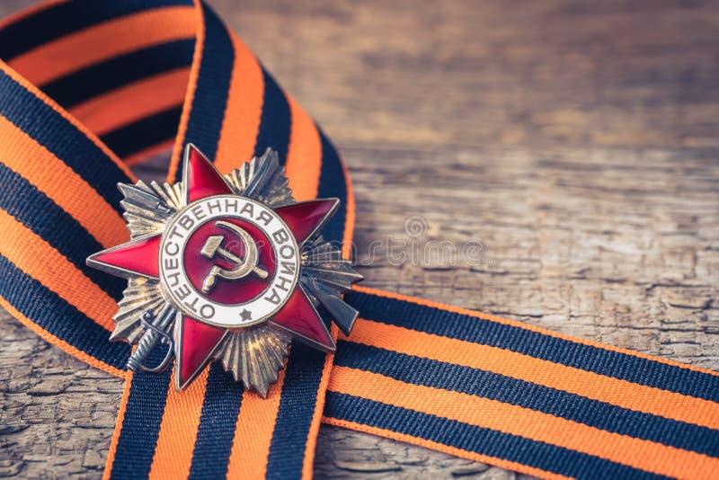 La orden soviética de la Segunda Guerra Mundial y del George cinta Victory Day concepto de la postal del 9 de mayo imágenes de archivo libres de regalías