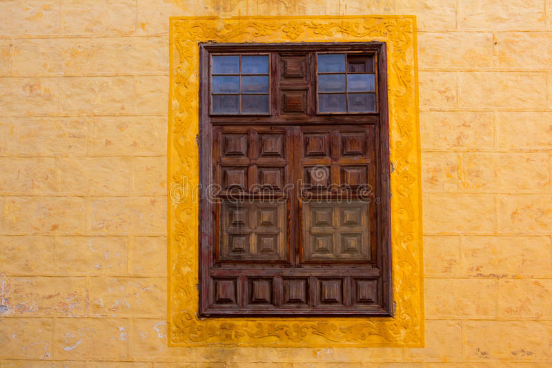 La Orotava wooden window in yellow wall Tenerife. At Canary Islands stock photography