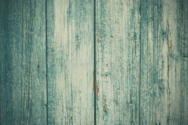 La oscuridad dilapidó los tableros agrietados, cerca verde Tabla vieja de madera pintada Textura r?stica de la madera Tablones re foto de archivo libre de regalías