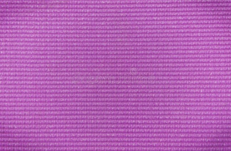 La púrpura coloreó textura de la estera de la yoga dng imágenes de archivo libres de regalías