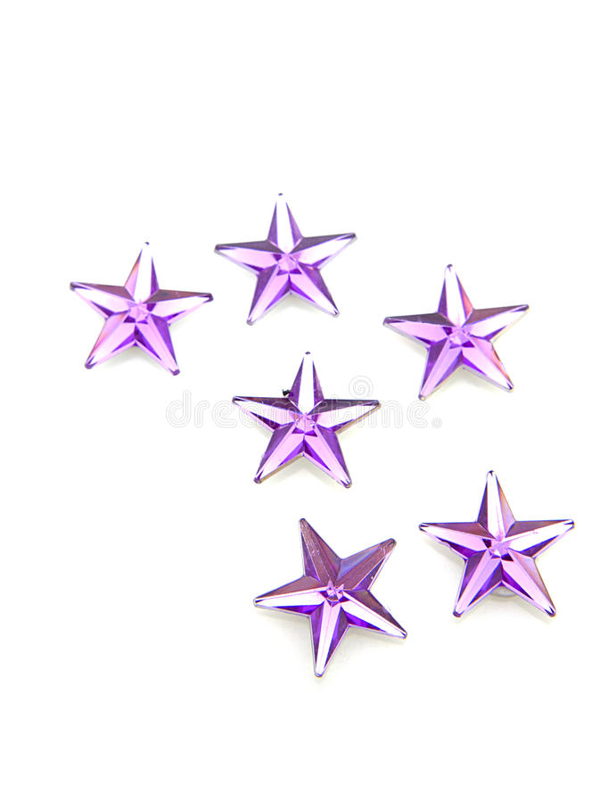 La púrpura stars confeti fotos de archivo