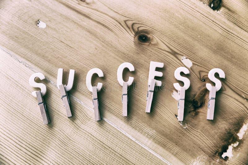 La palabra conceptual del negocio recogió de elementos de madera con el l foto de archivo libre de regalías