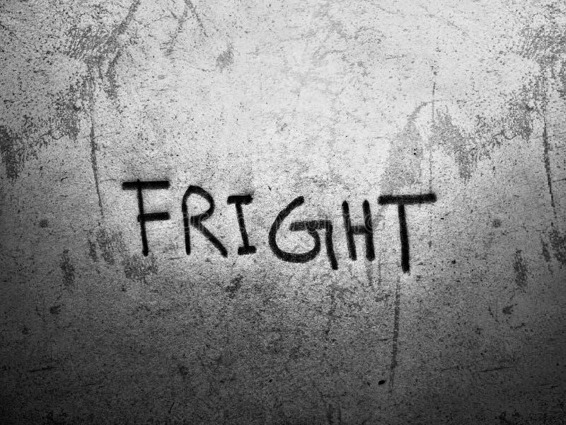 la palabra inglesa fright escrita con lápiz en una pared áspera fotografía de archivo libre de regalías