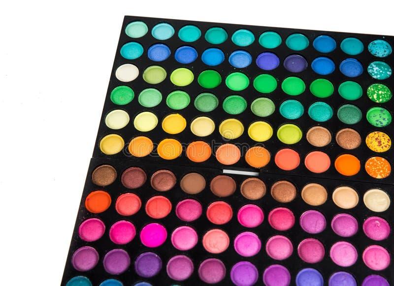 La paleta del cosmético multicolor compone, paleta de la sombra de ojos, textura colorida de las sombras, círculos de color redon fotos de archivo