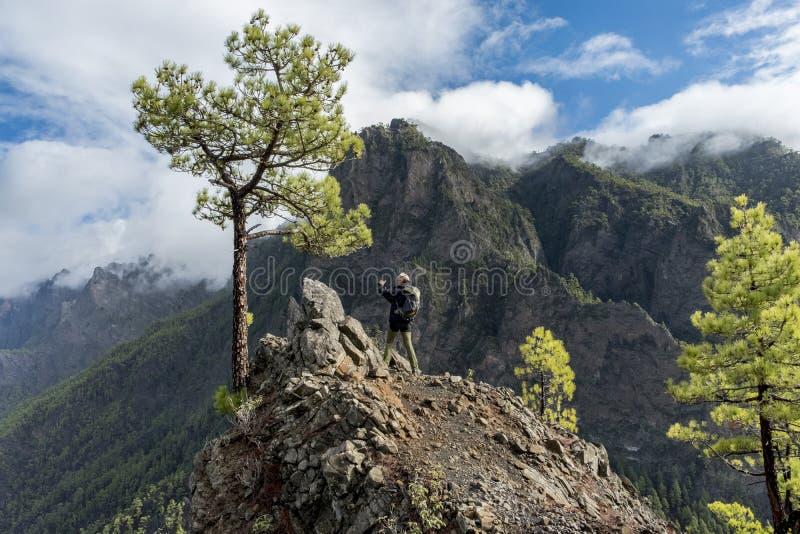 La palma cumbrecita mountains viewpoint woman photographing. Cumbrecita mountains in the `Caldera de taburiente` national park. The picture shows a photographing stock images