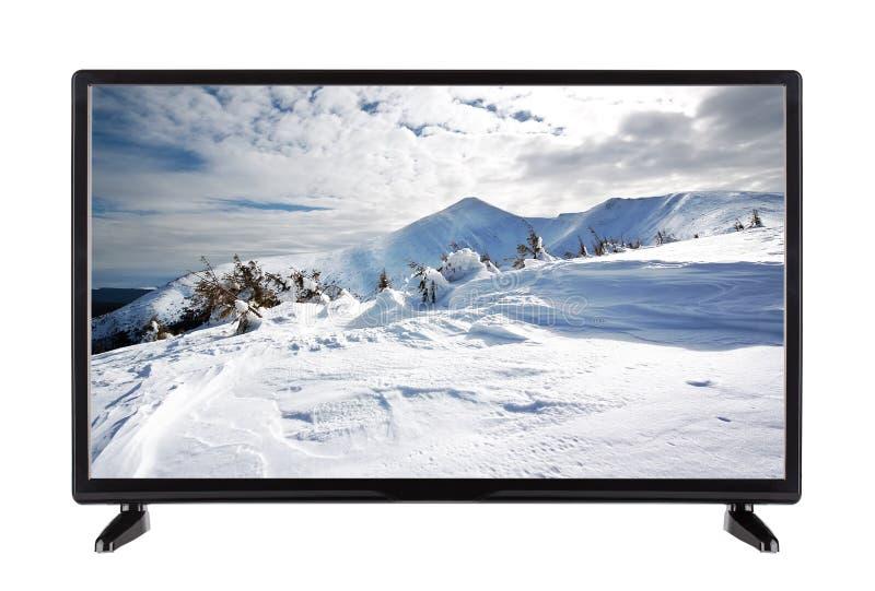 La pantalla plana TV con la alta resolución y el invierno ajardinan en ella foto de archivo