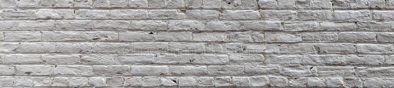 La pared de ladrillo blanca vieja de la bandera pintó blanco libre illustration