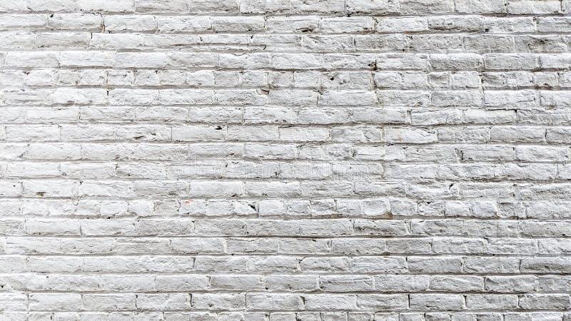 La pared de ladrillo blanca vieja hermosa pintó blanco stock de ilustración