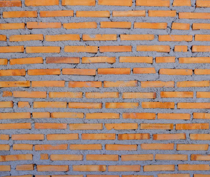 La pared de ladrillo roja todavía se está construyendo, fondo de la textura imágenes de archivo libres de regalías