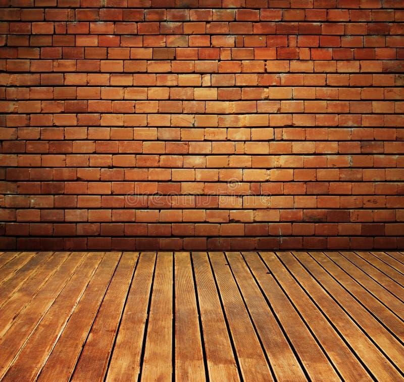La pared de ladrillo y la madera de la vendimia suelan el interior de la textura imagen de archivo libre de regalías